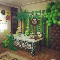 Image may contain: indoor Safari Theme Birthday, Jungle Theme Parties, Wild One Birthday Party, Baby Boy 1st Birthday, Jungle Party, Safari Party, Boy Birthday Parties, Birthday Balloons, Deco Jungle