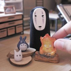 More Ghibli's characters! Kaonashi, Calcifer, and the blue and white Totoro. I didn't intend to make them this small, but I couldn't help it.. Made of air dry clay.