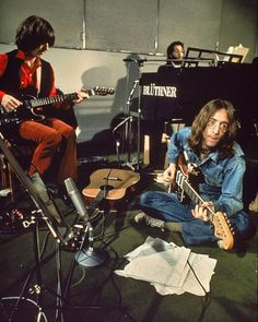 George, Paul and John at work in the studio