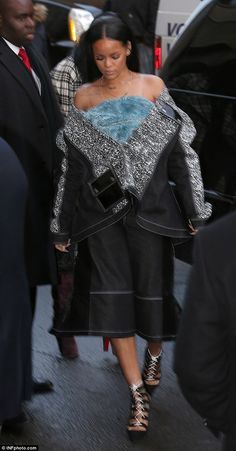 Revealing: Rihanna sported the jacket low on her shoulders, showing off a furry, blue top she sported underneath