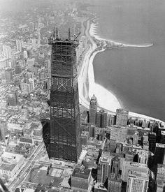 Topping ceremony for the Hancock Building, c.1968, Chicago. It's hard to see, but a time capsule is being installed on the top floor…I haven't been able to find what the contents are. Any ideas?  It's amazing how this building dominated the landscape…