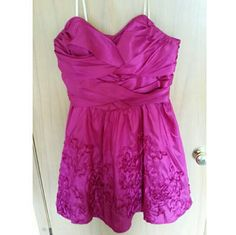 Fancy fushia  homecoming/prom dress Super cute fusia colored dress Has more of a formal look, would be great for a wedding or homecome, has a heart shaped top and very flattering shape. Size 16/17, i wear a size 13 jean and this fit me Originally paid $85 Asking price is MORE THAN HALF OFF   No trades  Most offers will be considered Happy poshing!  Remember, bundle and save! Deb Dresses Strapless