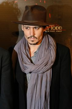 I also like the off beat style that John Depth has going - I am not a big fan of the scarves how ever.  I am not a fan of things around my neck.  20 Best Dressed Men in Hollywood | Fox News Magazine