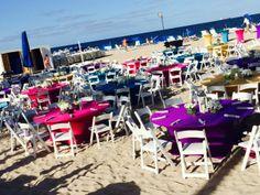 Bright colors pop against a sandy backdrop! www.koncetevents.com | #KonceptEvents