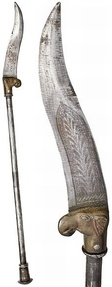 "Indian bhuj or kutti  known as ""elephant knife"", 19"" handle,10"" knife blade with etched designs, brass elephant head holding the knife blade. It is a weapon native the Sind and to North Western India."