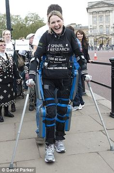 Claire Lomas crossing the finish line - Virgin London Marathon, May 8, 2012. Paralyzed from the waist down since a horse riding fall in 2007, she took 16 days to complete the 26 mile route. Averaging 2 miles/day with the help of a bionic ReWalk suit, she earned 150 thousand dollars for spinal cord research. Because she has no use of her legs, she had to steady herself with crutches and consciously will every single step she took. Photo by David Parker
