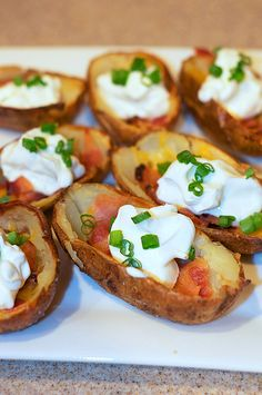Potato skins - cheap & easy appetizer. Put the bacon on the side to make it vegetarian. Cut in quarters for easy bites.