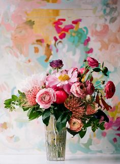 """loose and easy. I want a """"oh these? I just picked them out of my fabulous garden. NBD"""" look to the florals. Nothing too perfect or organized."""
