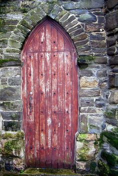 Llandudno, Conwy, Wales / The worn, warm red of the stout wooden planks makes a perfect match for the strength of the stone. One asks: what lays beyond? A Journey Through Medieval Life Porte Cochere, Cool Doors, Unique Doors, Portal, Door Knockers, Door Knobs, Gates, Porches, When One Door Closes