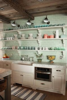 Marie Flanigan Interiors - I love the green glass subway tile and all the pretty dishes displayed on the open shelves!