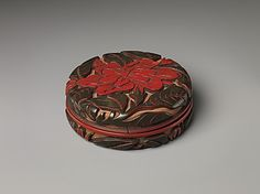 Box with Camellias--red and green lacquer/cinnabar.