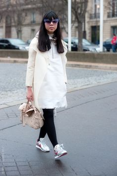 Susie Bubble lets her metallic Nike's stand out by pairing them with neutrals.