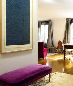 magenta bench, cream rug, art
