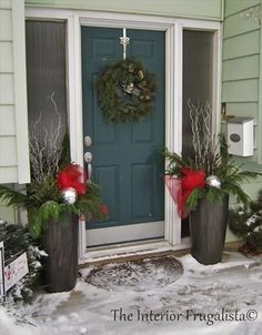 Pretty Outdoor Planters flanking the front door for the holidays!