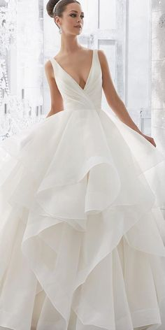 Love the skirt of this bridal gown