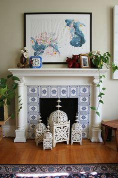 Love this fireplace, Design*Sponge Fireplace Tile Surround, Faux Fireplace, Fireplace Mantle, Fireplace Surrounds, Fireplace Design, Fireplaces, Fireplace Fronts, Fireplace Tiles, Home Interior
