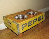 Vintage Elevated wood wooden Crate dish bowl Feeder for your dog yellow Pepsi crate repurposed dog feed station. For the kitties! Repurposed Furniture, Pet Furniture, Furniture Ideas, Dog Feeder, Dog Crate, Diy Stuffed Animals, Pet Gifts, Wood Boxes, Unique Vintage