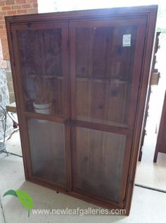 A classic wooden gun cabinet with glass doors to display your pieces.