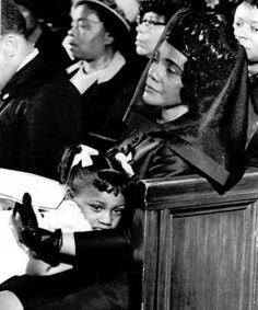 Coretta Scott King and daughter Bernice, 5, at King's funeral.
