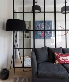 A glass room divider is a great choice for separating a space and making sure both areas receive adequate natural light.