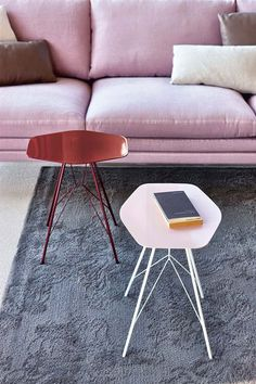 Side tables by Frank Rettenbacher for Zanotta. Austrian-born Frank Rettenbacher designed the Mina and Emil tables with slender surfaces and legs braced with thin steel wires that loop around each other to form a sturdy frame.