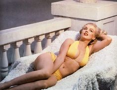 Marilyn Monroe- A beautiful woman that men lusted after... yet look at her size! She is no skinny model who needs to eat 50 cheeseburgers, she is a real woman who has curves and is truly beautiful... she wore a size 12, and was a huge lust and beauty, yet in this world today people think to be pretty you have to be a size 0... not true!! Truly an amazing role model is she to me.