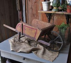 Hey, I found this really awesome Etsy listing at https://www.etsy.com/listing/225558531/antique-childs-wheelbarrow-with