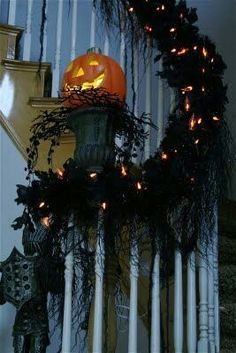 Halloween black feather boa adorned with LED lights makes great staircase decor!  Get the feather boas needed to recreate this look here: http://www.craftsfeathersfloral.com/home/cff/page_7055_1129/chandelle_boa_black_p7055.html
