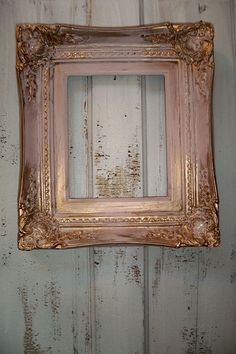 Pink gold wood frame vintage ornate heavy wood 8 by 10 shabby chic thick wall decor Anita Spero    This is a beautiful, heavy, well-made ornate frame. It is 8 by 10, and the outside is 15 by 17, so that lets you know how wide it is. Gorgeous for a baby nursery, or an important photo or painting. This has been distressed in gold and pink, and to that was added a distressing treatment.
