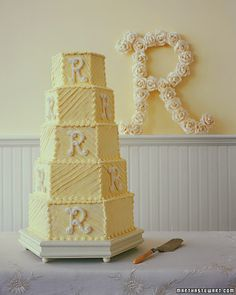 In+a+cheerful+tower+of+a+cake,+five+deep+hexagonal+layers+are+iced+with+buttercream;+the+tiers+are+piped+with+a+star+tip+in+opposite+directions+for+a+patchwork+effect.+The+initials+are+made+of+air-dried+meringue.+Extra+meringue+letters+were+made,+so+each+delicious+slice+of+French+orange+pound+cake+with+Grand+Marnier+buttercream+frosting+could+be+served+with+its+own+R.
