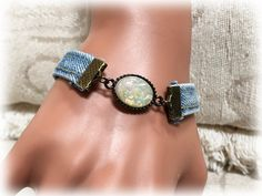Lots of ladies begin their beauties collection when still in youth, and the appeal bracelet grows in addition to them, reflecting pastimes and experiences. Denim Bracelet, Spoon Bracelet, Fabric Bracelets, Handmade Bracelets, Handcrafted Jewelry, Denim Crafts, Jean Crafts, Denim Belt, Vintage Jewelry Crafts