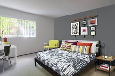 Bedroom With Light Gray Paint And Dark Gray Accent Wall Behind Bed Grey Accent Wall Living Room Grey Accent Wall Accent Wall Colors