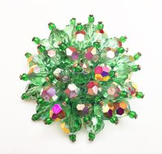 For your consideration is this green crystal cluster bead brooch. It consist of facet cut green crys