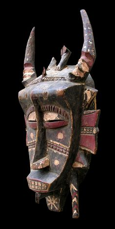 Africa | Kpelie mask from the Senufo people | Wood and paint