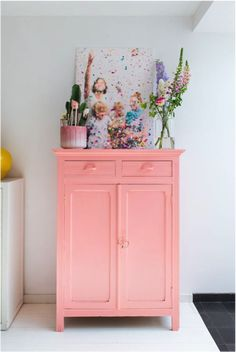 This bathroom has a big personality with its popping pink vanity, confetti artwork and pretty storage. Sift through thrift stores and vintage shops to find a little cabinet that will fit into your bathroom, and then whip out the pink paint you've been dyi