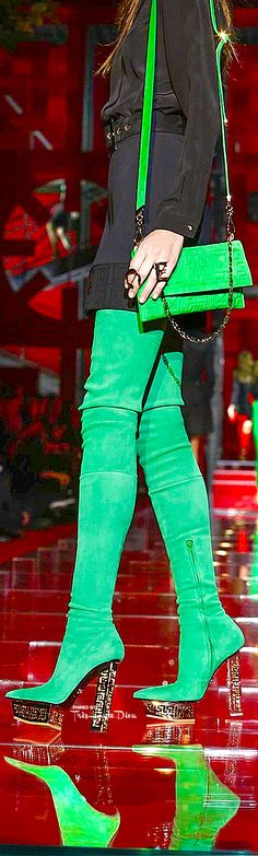 Versace 2015. The greens would look better perfectly matched rather than slightly off like they are here, another color handbag would look better than coming so close but not quite matching...the boots are fly though.