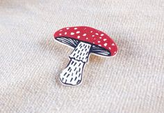 Description  -------------------  Featuring my original illustration of a Fly Agaric Mushroom.  Made from shrink plastic with a silver brooch