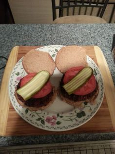 A new variation on a classic, well, not really new...  Hamburgers (beef), sprinkled with a garlic pepper seasoning, grilled for about 20 minutes and garnished with fresh mozzarella (under the tomato), tomato, and a sandwich slice pickle.  Served on a grilled wheat bun.  Lovely!