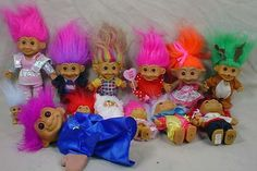 trolls...I had one with bright yellow hair and hot pink hair.  I thought they were so cool!   images.search.yahoo.com- we call them wishniks