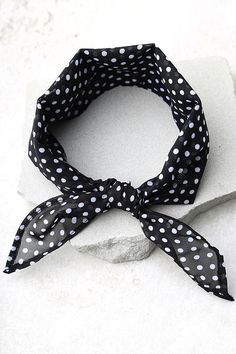 "Channel your inner vintage vixen with the Vanessa Mooney Rosalie Black and White Polka Dot Bandana! Vintage, woven, dead stock fabric, with petite white polka dots, forms this triangle bandana with a classic look. Bandana measures 12"" wide and 27"" long."