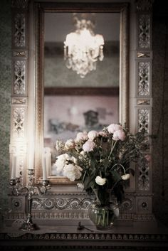 Breaking out the silver and crystal for a special occasion and swapping the painting over the fireplace with a mirror... great idea...