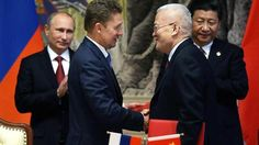 Gazprom CEO Alexei Miller and CNPC General manager Zhou Jiping shake hands as Vladimir Putin and Xi Jinping look on, Shanghai, May 21, 2014.