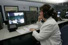 In this picture a nursing instructor operates high-fidelity simulators from a control room. Studies have identified an association between technology-enhanced clinical simulation training and improved outcomes for clinicians and patients (Johnson, et al., 2012).