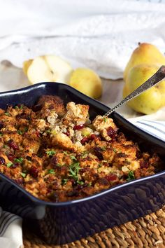 This amazing stuffing recipe is loaded with pears, cranberries, sausage and buttery brioche to create a fabulous flavor party perfect for Thanksgiving, Christmas and beyond.   @The Suburban Soapbox