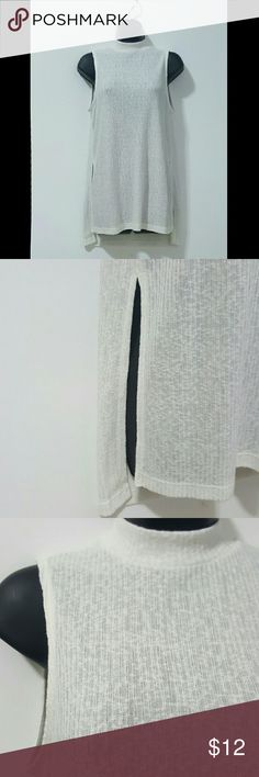 "NWOT. H&M DIVIDED Mock Turtleneck Ribbed Tank NWOT. Lightweight sweater material. Semi-sheer. Ribbed. Shoulder to hem is 28"" in front and 30"" in the back. 10"" slit on side. Color is Ivory! Divided Tops Tank Tops"