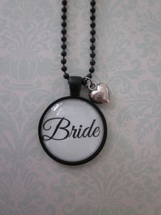 Black/White Bride Glass Pendant Necklace by CharmedDesignsByJC, https://www.etsy.com/listing/116636140/blackwhite-bride-glass-pendant-necklace