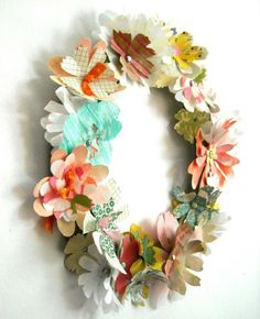 cute... wreath made out of paper flowers. Beautiful <3