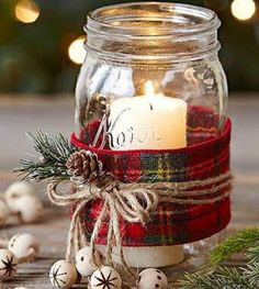 For a Mason jar gift you can make in bulk, try these easy candles. Wrap the jar with wide plaid ribbon. Secure with three jute strings tied in a bow. Hot-glue a pinecone and artificial greenery to the bow. For a final touch, wood-burn a snowflake or polka Mason Jar Christmas Crafts, Christmas Candles, Jar Crafts, Christmas Candle Decorations, Rustic Christmas Crafts, Mason Jar Gifts, Mason Jar Diy, Elegant Christmas, Christmas Home