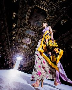 """Yesterday in Paris @driesvannoten presented his colorful spring/summer 2018 collection at the Hôtel de Ville. Prints and scarves were at the core of the collection debuted by models who walked the runway in glittery boots and strappy heels to the sounds of DM Smith's """"Be My Baby"""". Photo by @kevintachman. #pfw via NY TIMES STYLE MAGAZINE OFFICIAL INSTAGRAM - Celebrity  Fashion  Haute Couture  Advertising  Culture  Beauty  Editorial Photography  Magazine Covers  Supermodels  Runway Models"""
