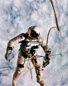 Astronaut Edward White spacewalking outside his Gemini capsule. In orbit June 1965.